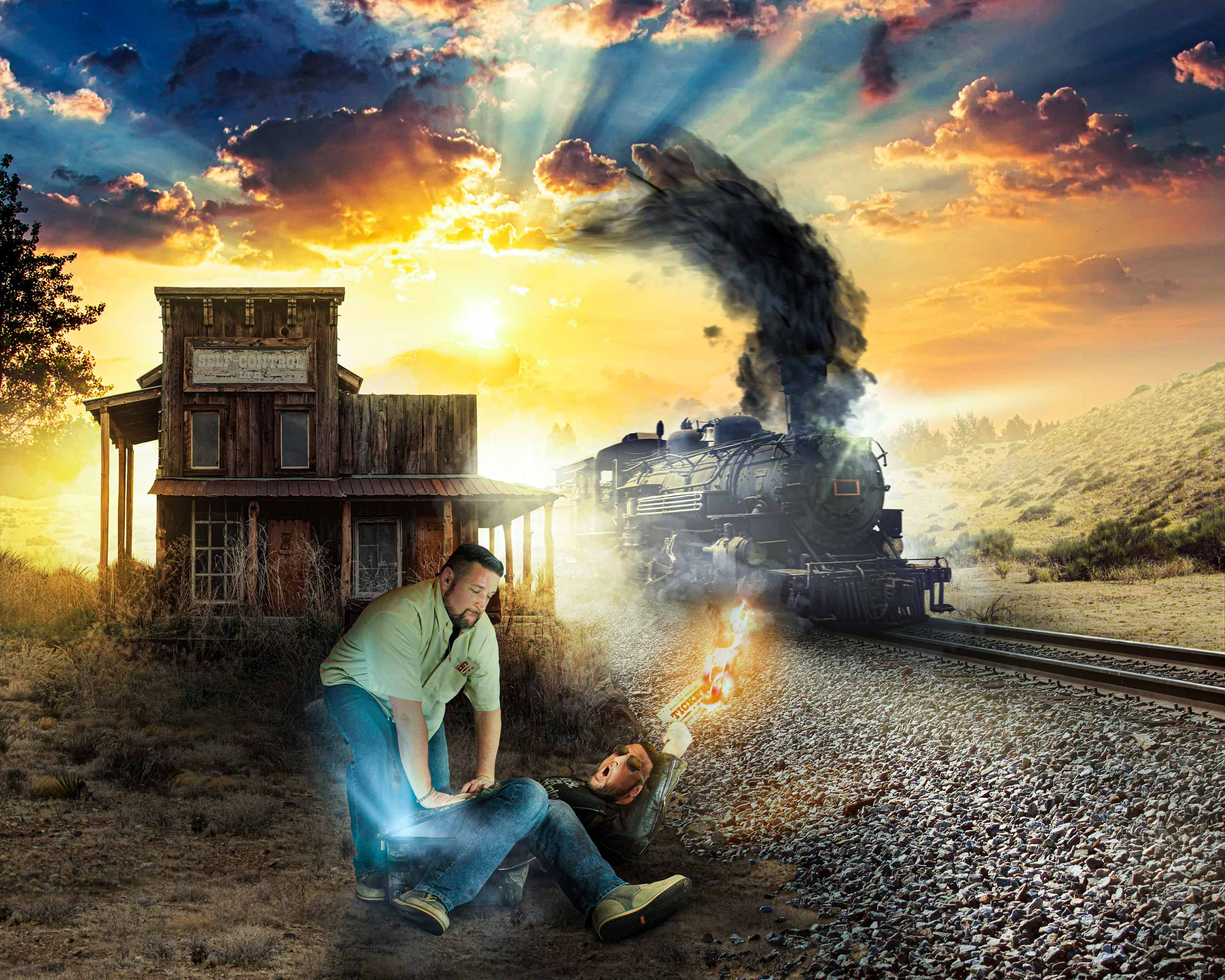 A man tries to restrain his evil clone into a suitcase as an old steam engine train races past the train station.